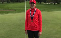 A champion at last: senior Lauren Beaudreau wins girls golf state title